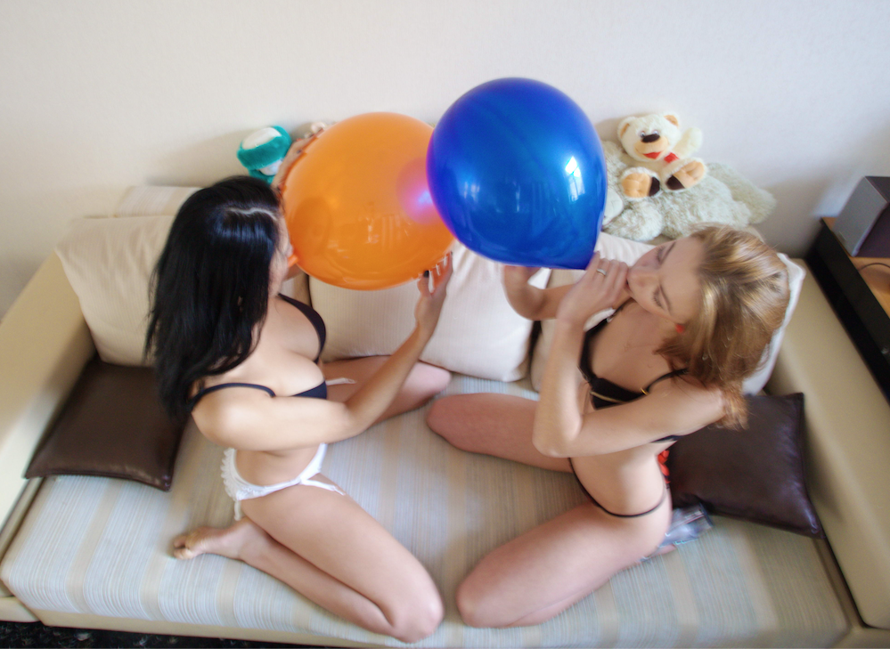 Alissa and Gia blow to pop balloons
