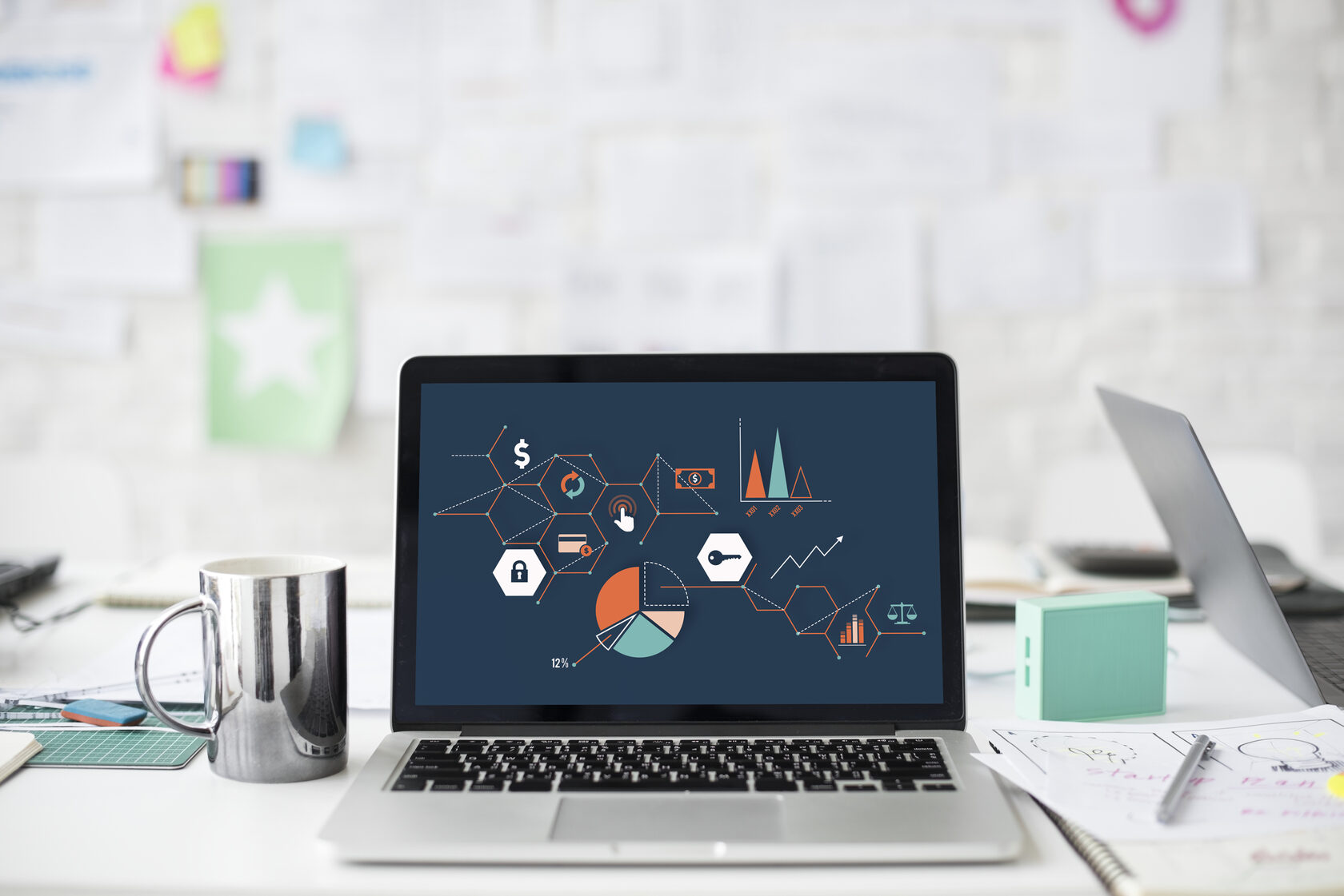 Laptop with the image of growth graphs and charts