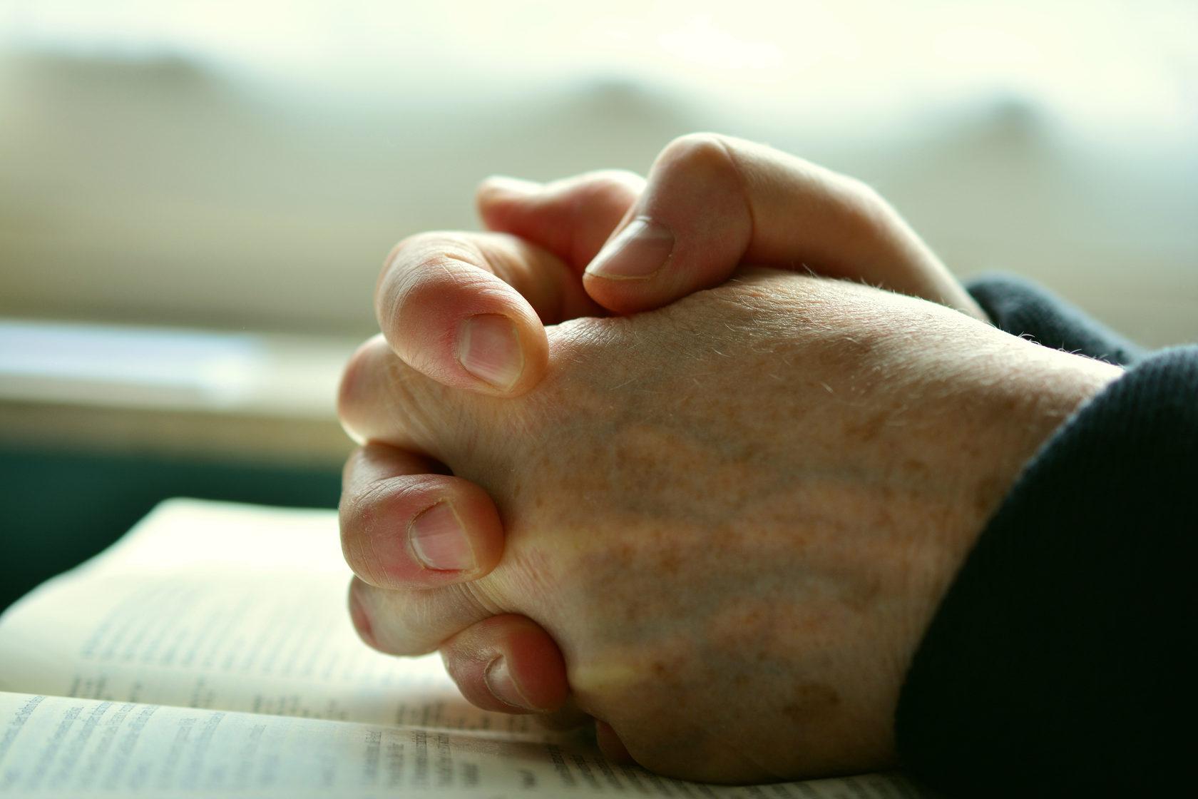Prayer, clasped hands