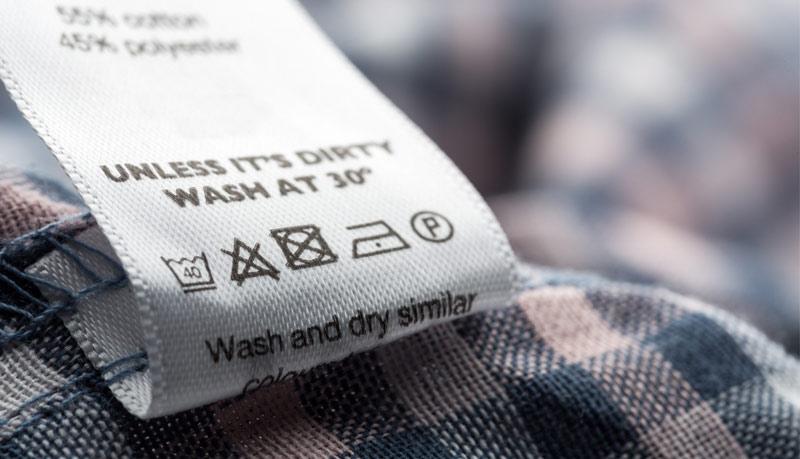 Вижте символите за пране, гладене и сушене на етикета на дамските палта, якета и шлифери