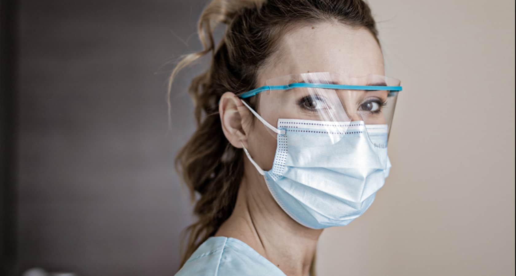 A woman wearing goggles and a facemask