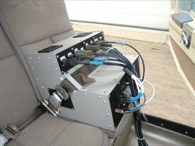 Figure 4 – ALMA G2 D-Box Secured to Backseat with Seatbelt