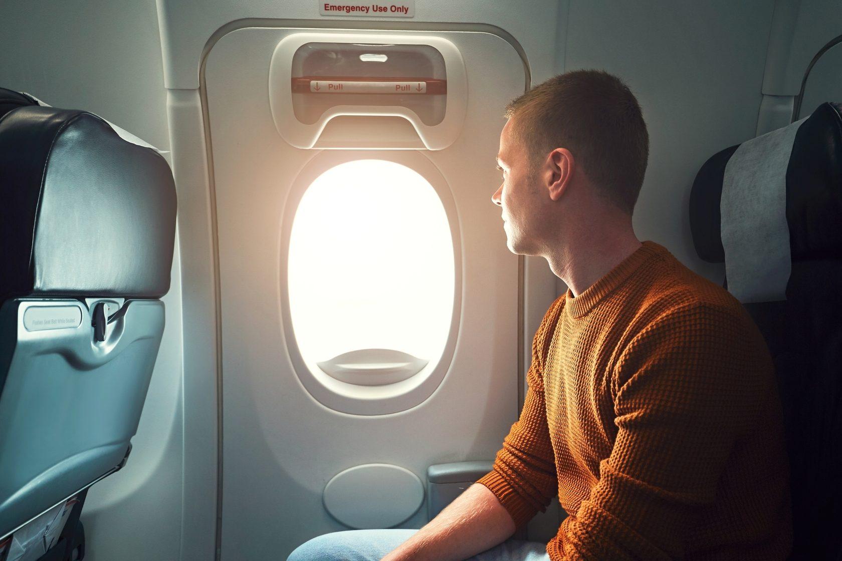 условно назвали картинка человек сидит у иллюминатора самолета московской области введен