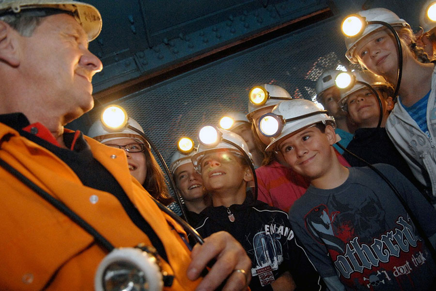 People with helmets at Big Pit mining museum