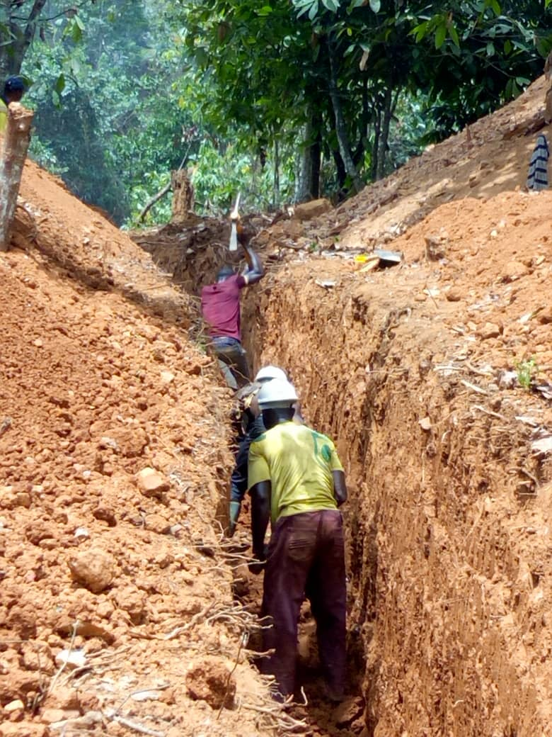 KUBI village workers hand digging trench