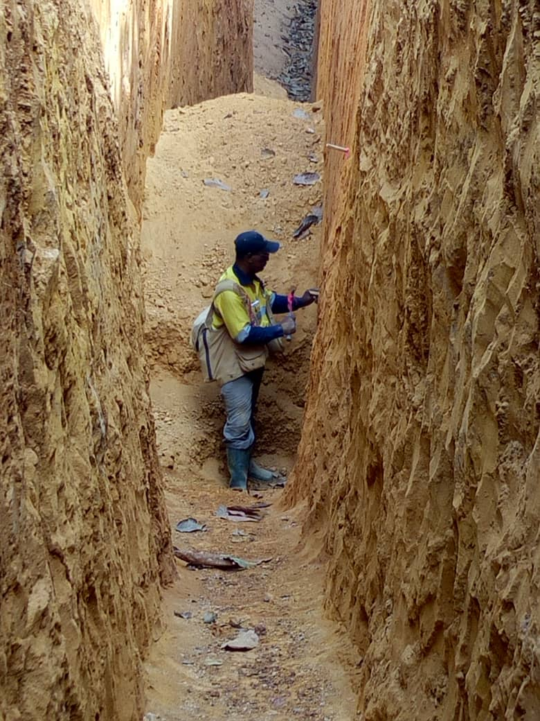Eddie Norman preparing trench for sampling