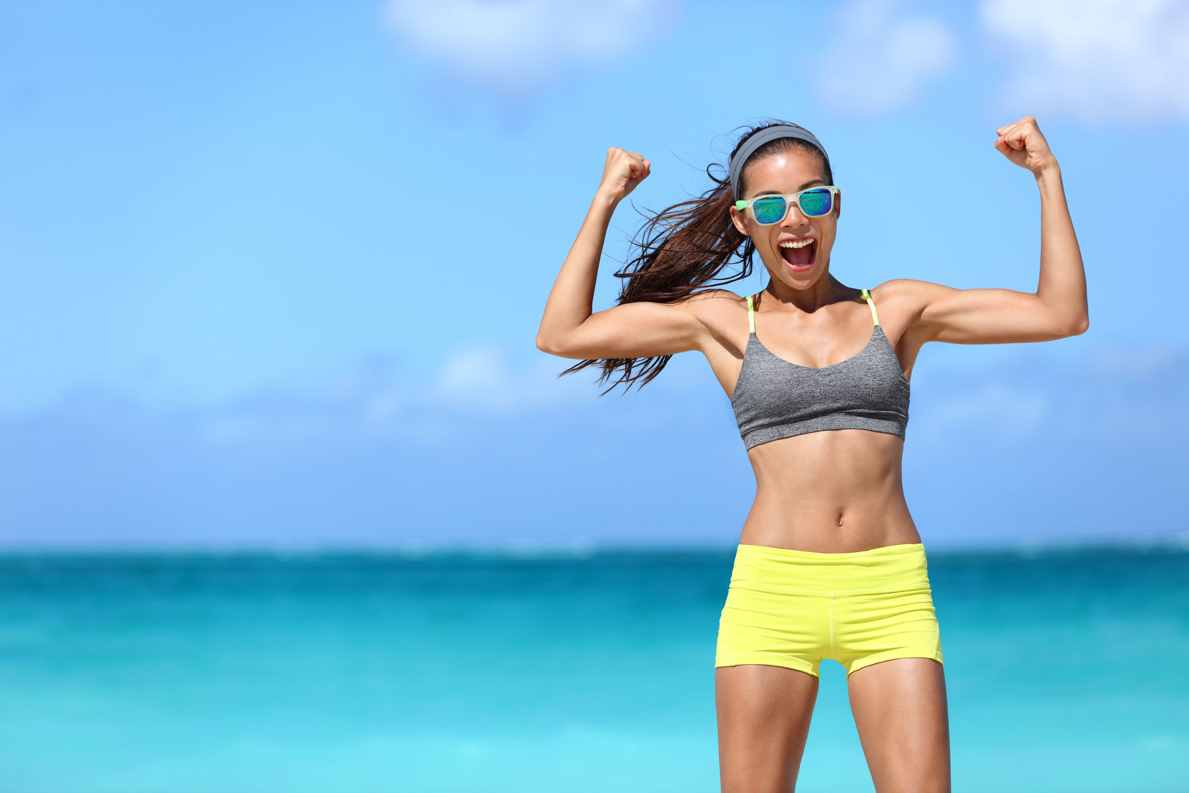 Start Your Summer Off with a Cardio Dumbbell Workout on the Beach!