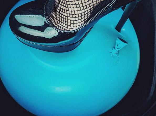 High heel balloon popping