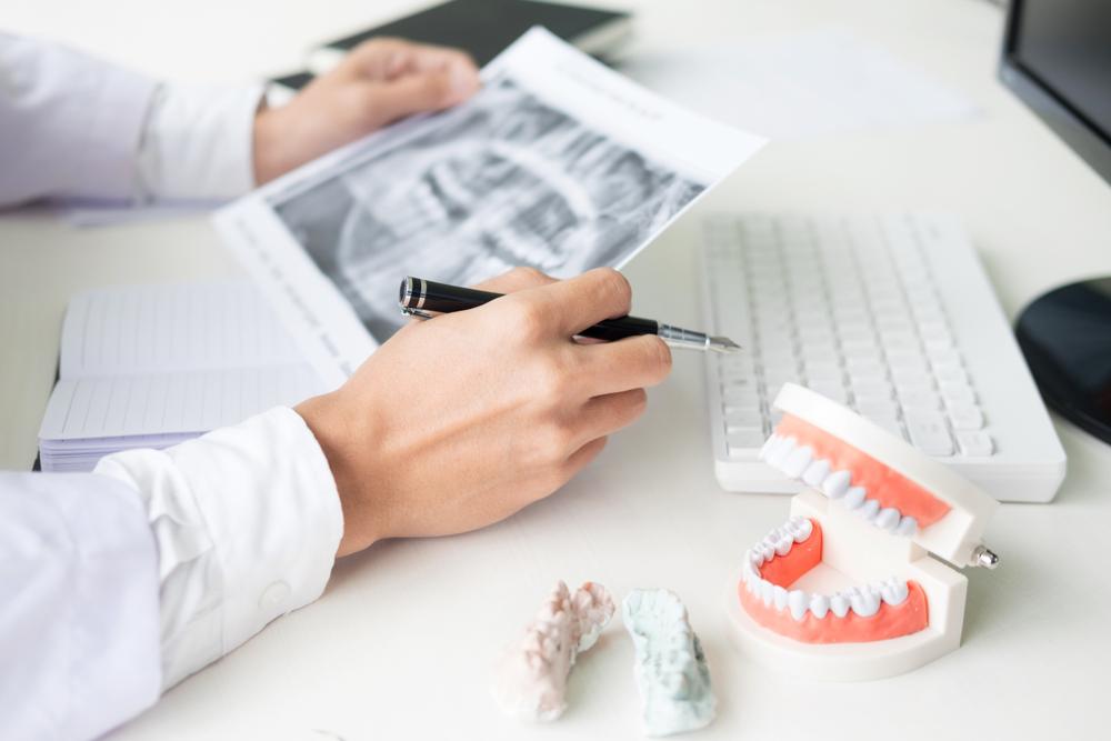 Удаление зубов на нижней челюсти