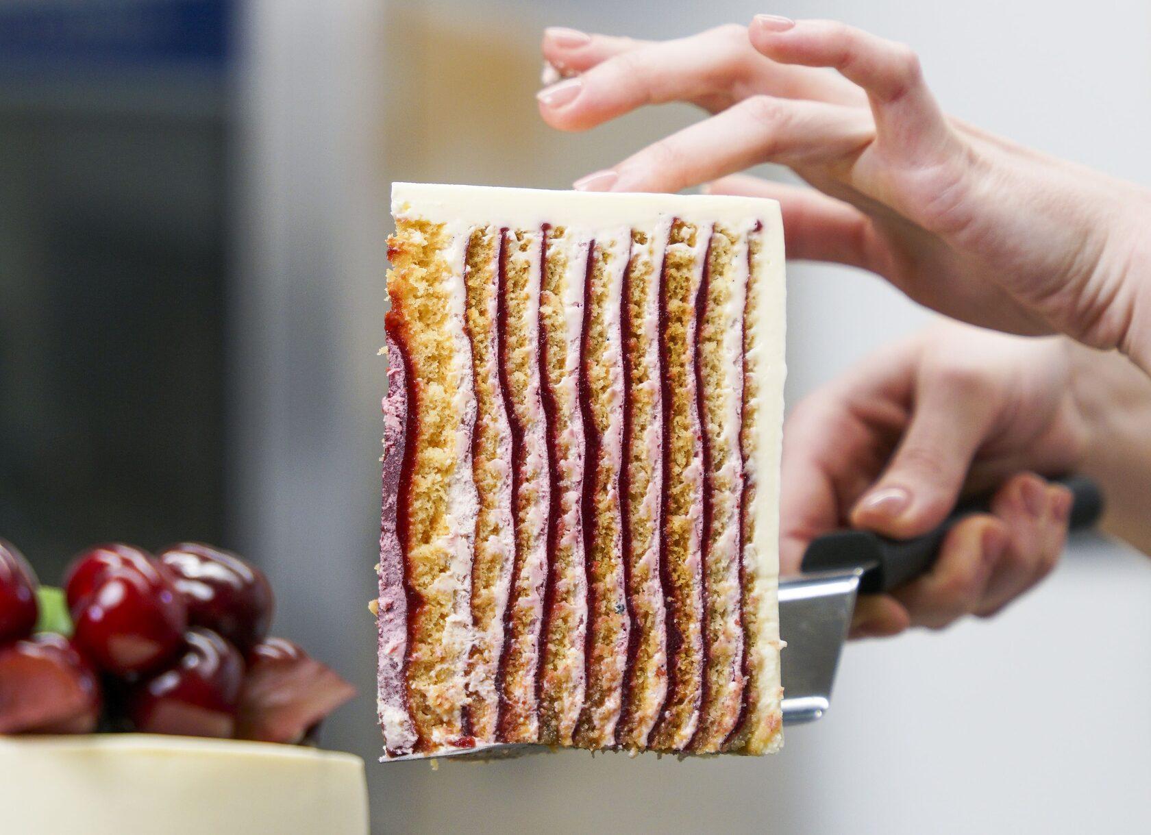 Cherry Velvet vertical layer cake cut photo