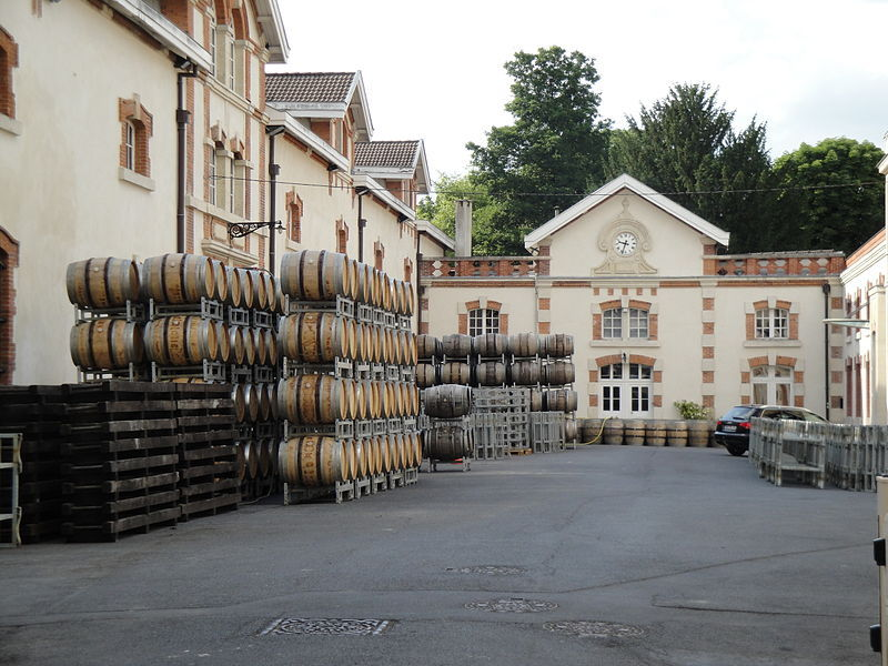 The courtyard of Krug's production facility in Reims with empty oak barrels that have been used for the primary fermentation of their Champagnes.