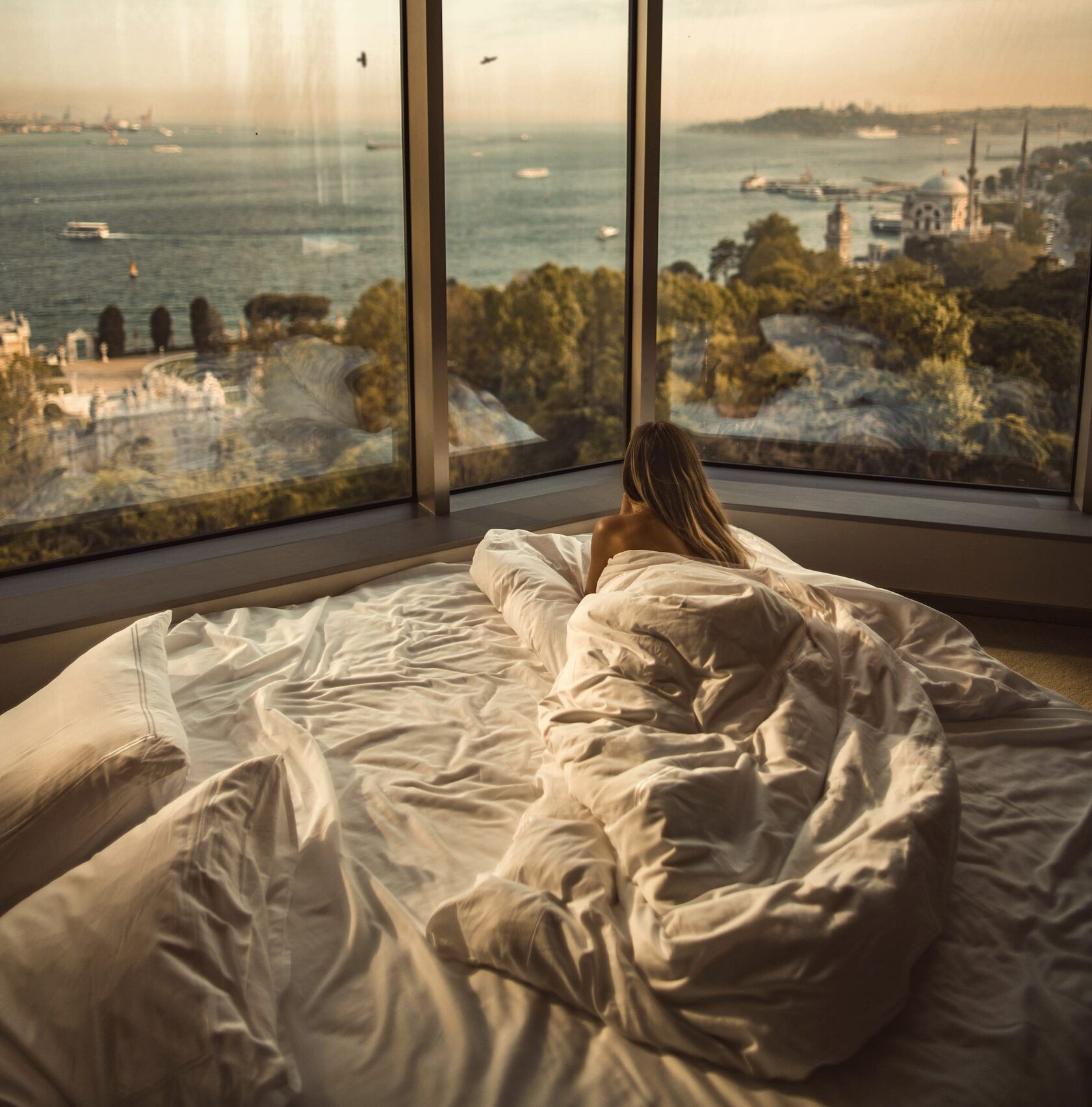woman looks through the panoramic windows at a beautiful view