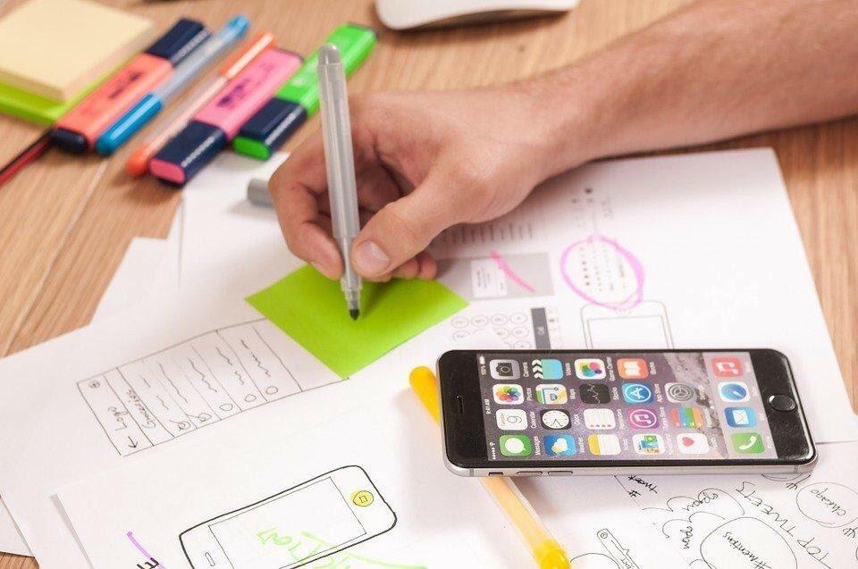 man drawing initial prototype of app