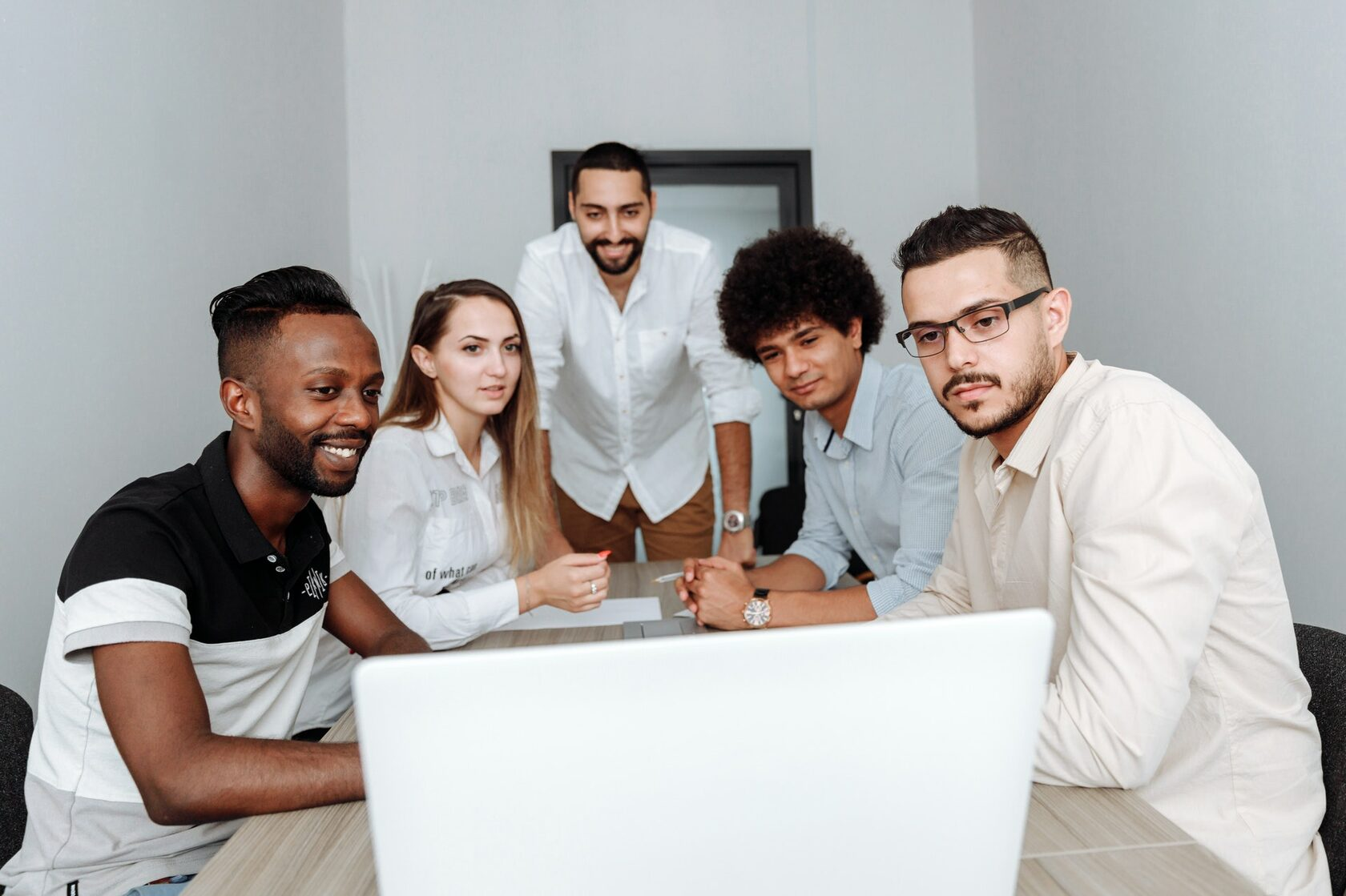An image of a group of people in an office setting working for a company